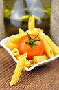 Raw penne pasta in a small bowl, selective focus Stock Images