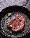 Raw pork chop in pan Royalty Free Stock Photo