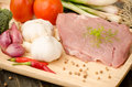 Raw pork for cooking with vegetable on wooden plate Royalty Free Stock Photography