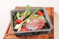 Raw pork and fresh vegetables in a baking pan Stock Photos