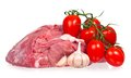 Raw pork with ripe tomatoes and garlic cloves on a white background Stock Image