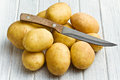 Raw potatoes with knife Royalty Free Stock Image