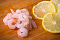 Raw prawns with lemon slices Stock Image