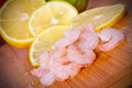 Raw prawns with lemon slices Stock Photography