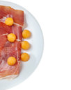 Raw prosciutto with melon on white Stock Image