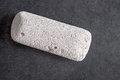 Raw pumice stone on table light weight and with rough surface Royalty Free Stock Images