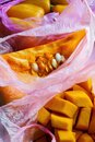 Raw pumpkin pieces in plastic bags, zero waste, smart consuming Royalty Free Stock Photo
