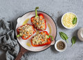 Raw quinoa stuffed sweet peppers in a cast iron skillet. Top view. Healthy, vegetarian food Royalty Free Stock Photo
