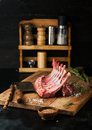Raw rack of lamb with spices on a cutting board Royalty Free Stock Photo