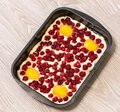 Raw raspberries and apricots pie on a oven-tray Royalty Free Stock Photo
