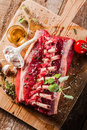 Raw Rectangle Rack of Lamb Chops on Wooden Board Royalty Free Stock Photo