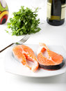 Raw salmon on dish Stock Photography