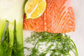Raw salmon fillet dill fennel and lemon on white table wooden Royalty Free Stock Images