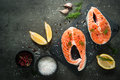 Raw salmon steak with food ingredients. Royalty Free Stock Photo