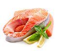 Raw salmon steak red fish with herbs and lemon on white Stock Photos