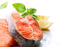 Raw salmon steak red fish with herbs and lemon on white Stock Photo