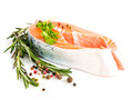 Raw salmon steak with rosemary isolated on white Royalty Free Stock Photo