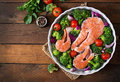Raw salmon steak and vegetables Royalty Free Stock Photo