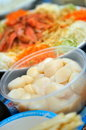 Raw scallops and raw fish salad Stock Images