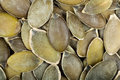 Raw shelled pumpkin seeds healthy food organic nutrition as background or texture Stock Photo