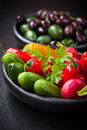 Raw snack vegetable with olives in the background Royalty Free Stock Photos
