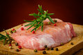 Raw steak and spices still life with pepper rosemary Royalty Free Stock Photo