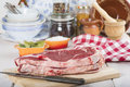 Raw steaks on the kitchen table Royalty Free Stock Photo