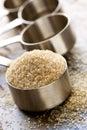 Raw Sugar in Measuring Spoon Stock Photos