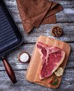 Raw T-bone steak and iron grill pan Royalty Free Stock Photo