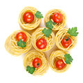 Raw taliatelli pasta cherry tomatoes Royalty Free Stock Photos