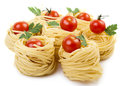 Raw taliatelli pasta cherry tomatoes Stock Photography