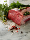 Raw tenderloin with mixed herbs Stock Photo