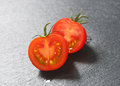 Raw tomato halves Royalty Free Stock Photo