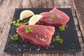 Raw tuna and fresh ingredients Royalty Free Stock Photos