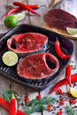 Raw tuna with spices fresh tail on wooden board red hot chili pepper fresh lime and dill selective focus Stock Photography