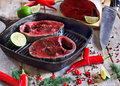 Raw tuna with spices fresh tail on wooden board red hot chili pepper fresh lime and dill selective focus Stock Photo
