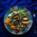 Raw vegan salad with persimmon kaki and pomegranate Stock Photo