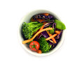 Raw vegetable salad in the bowl color on white background Stock Photos
