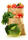 Raw vegetables and shopping bag isolated on white Royalty Free Stock Photos