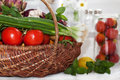 Raw vegetables in wicker basket variety of on white Royalty Free Stock Image