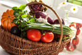 Raw vegetables in wicker basket variety of on white Stock Photography