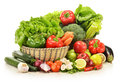 Raw vegetables in wicker basket on white Stock Image