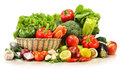 Raw vegetables in wicker basket on white Stock Photography