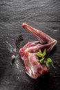 Raw venison haunch seasoned with herbs and spices high angle view of deer fresh on dark grey textured surface copy space Stock Images