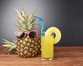 Raw whole pineapple on wooden surface table Royalty Free Stock Photo