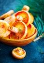 Raw wild Saffron milk cep mushrooms on dark old rustic background. Lactarius deliciosus. Rovellons, Niscalos. Organic mushrooms