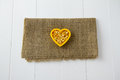 Raw yellow lentils nestled heart sitting burlap white wooden boards Royalty Free Stock Photography