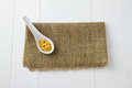 Raw yellow lentils white ceramic spoon sitting burlap white wooden boards Stock Images