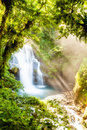 Rays over the waterfall Royalty Free Stock Photography
