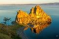 The rays of rising sun illuminate the rock Shamanka Royalty Free Stock Photo